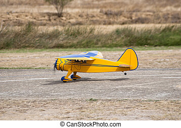 remote controlled yellow airplane