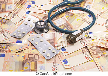 Increasing health costs - Stethoscop and medicine on a...