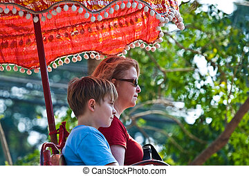 tourists on an elephant ride  in Ajutthaja