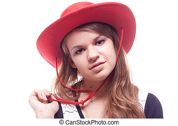 Portrait of a girl in a red hat studio photography