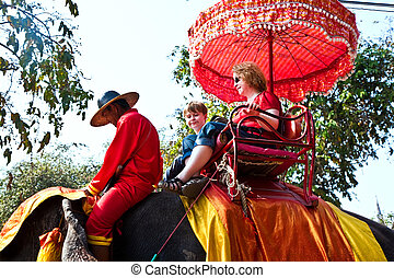 tourists on an elephant ride in Ajutthaja - tourists are...