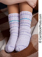 knitted socks on his feet