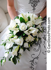 Brides white roses. - Brides bouquet is white roses.