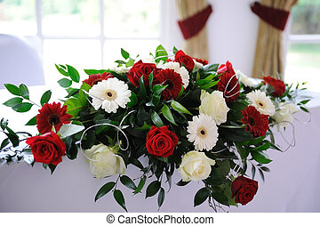 Red roses decorate table at wedding ceremony - Red roses...