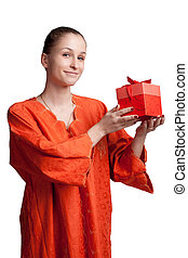 A girl in an orange smock with a gift of studio photography