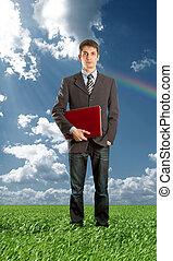 Full length portrait of businessman with laptop outdoors