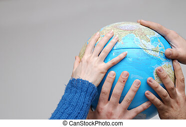 Teamwork concept with hands on globe...