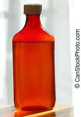 AMBER PRESCRIPTION BOTTLE - A closeup of an amber...