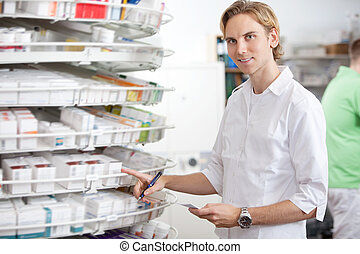Pharmacist at Work - Portrait of male pharmacist working at...