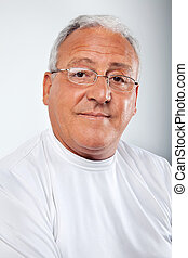Senior Man Wearing Glasses - Portrait of smiling senior man...