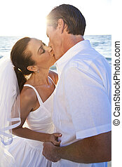 Bride & Groom Married Couple Kissing Sunset Beach Wedding