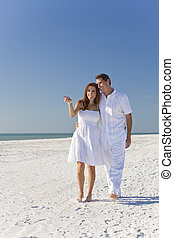 Romantic Man and Woman Couple Walking on An Empty Beach -...