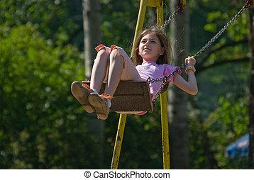 happy girl swinging (NIKON D80; 10.6.2007; 1/1000 at f/6.3;...