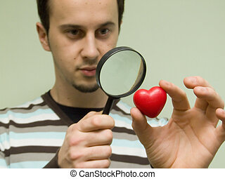 true love searching - hearth looking through magnifying...