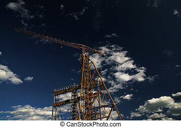 crane with dramatic clouds  in background