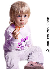 Small girl eating cookies on a white background