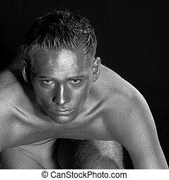 portrait of a silver bodypainted man