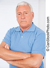 Serious Senior Man With Arms Crossed