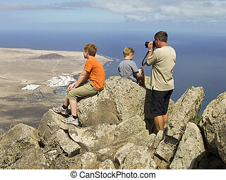 father takes pictures from Balcon de Femes with his children...