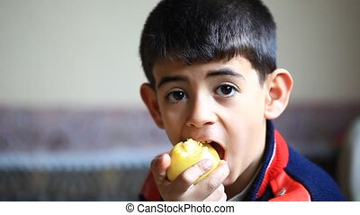 apple and little boys - the childs appetite to eat the apple...