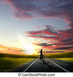 Man walking away at dawn along road - Collage with a human...