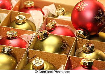 Christmas balls in box with paper wrapping - Red and green...