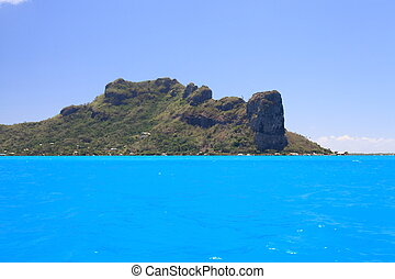 Dreamlike Colors of the Lagoon in Maupiti, French Polynesia. Maupiti Mainland in Background