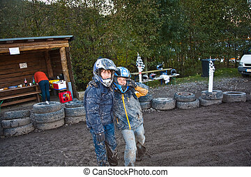 child loves to race with a quad bike at the muddy quad track