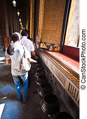 The giant Reclining Buddha in Wat Pho, Thailand - people...