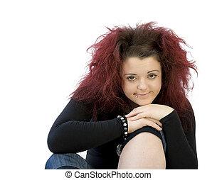 teenage girl with chin on knee