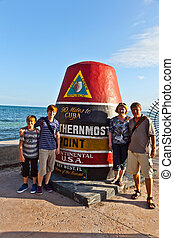 Southernmost Point marker, Key West, USA - family posing at...