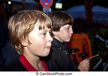 boy watches interested the scene by night