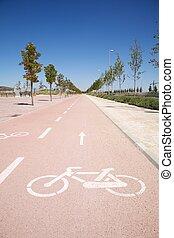 straight bikeway - bikers lane sign on the asphalt ground