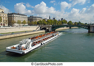 Seine river in Paris, France - Bateaux Mouches are open...