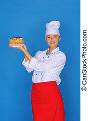 happy woman- cook holding cake on blue background