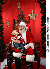 Toddler Sitting on Santas Lap - Baby boy sitting on Santas...