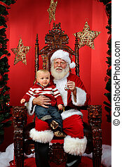 Baby Boy Sitting on Santa's Lap - Baby boy sitting on...