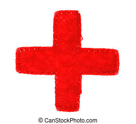 Medical red cross symbol made of fabraci on white background