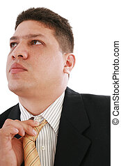 Business man fixing his tie, isolated over white