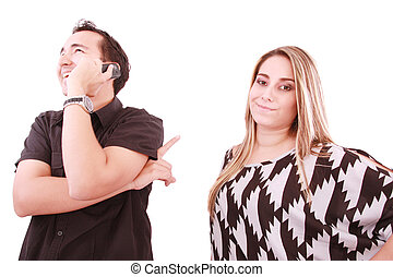 A problem of young families. Man talking on the phone, forgetting about his wife