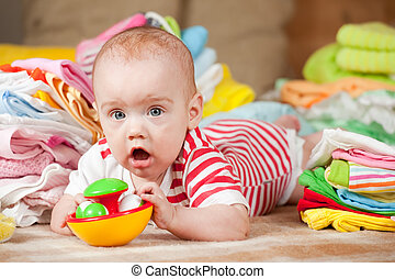 Happy baby with baby's things - Happy baby girl with heap of...
