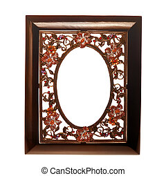 wooden frame with a metal insert in the form of flowers...