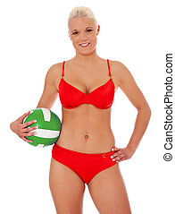 Volleyball - Attractive woman in bikini holding a volleyball...