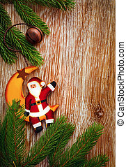 Christmas Fir Tree Border  and decorations on old wooden background