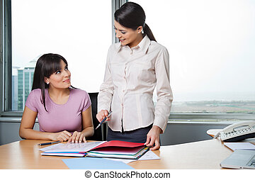 Women Discussing Business Reports