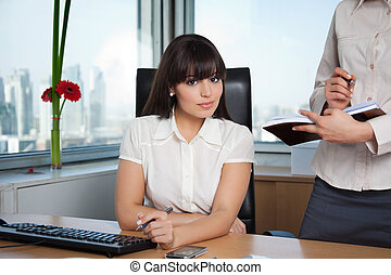 Female Executive With Assistant at Side - Portrait of female...
