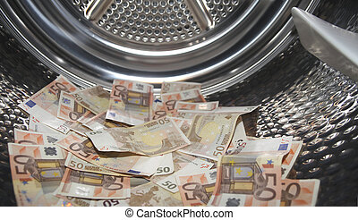 Money laundering - Euros inside washing machine. Concept for...