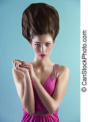 woman in pink with creative hair style