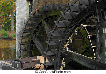 wheels of a sawmill - two wheels of an old water powered...