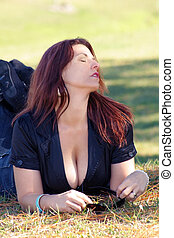 Busty Redhead Relaxing Outdoors 4 - A sexy, voluptuous...